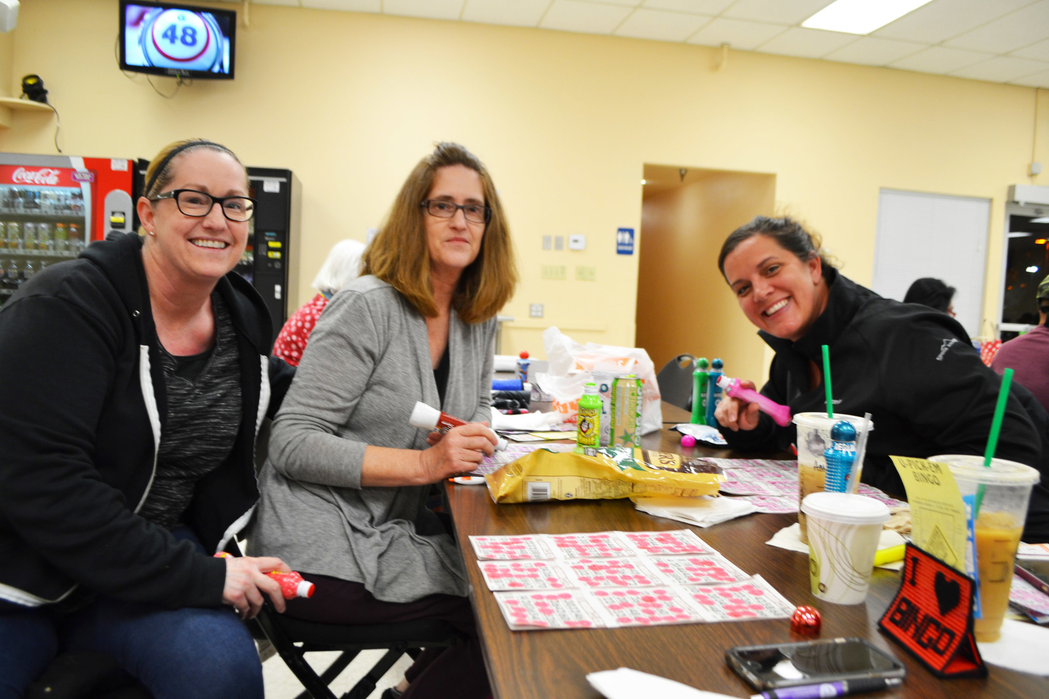 Kathy Galvez, Ursula Barnes and Amber Giacalone playing bingo at the Poway Senior Center. Galvez and Giacalone said bingo is their chance to do something fun and social with each other.