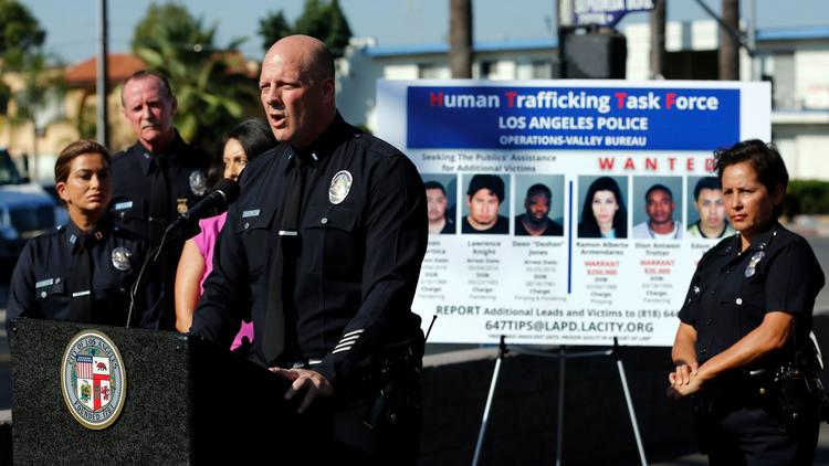 LAPD Lt. Marc Evans issues a Human Trafficking Task Force alert to the media in August 2016 in Van Nuys. New legislation would help protect victims of human trafficking in California. (Mel Melcon / Los Angeles Times)