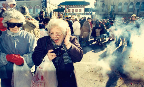 Chinatown visitors get an earful as revelers set off firecrackers to welcome in the Chinese New Year in1990.