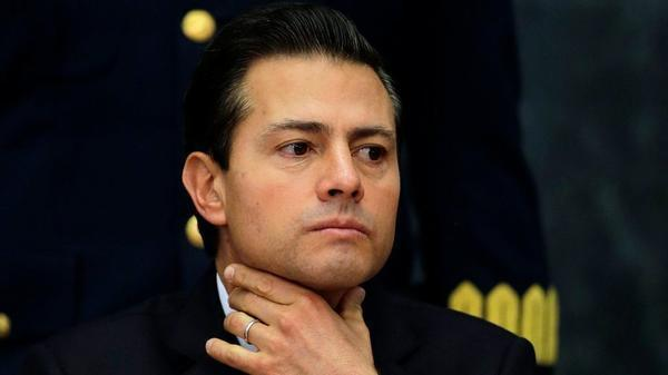 Mexico's President Enrique Pena Nieto pauses during a press conference at Los Pinos presidential residence in Mexico City, Monday, Jan. 23, 2017.