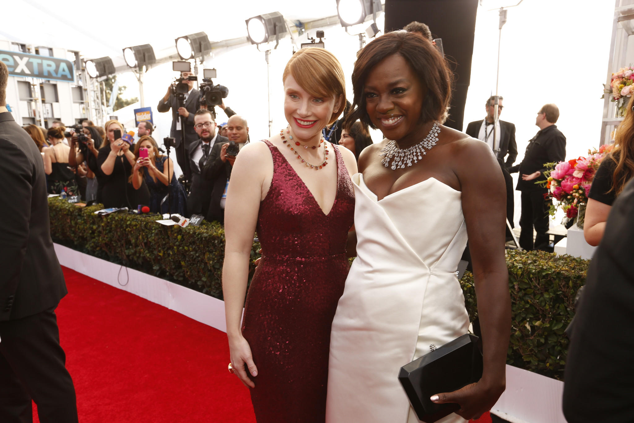 "Bryce Dallas Howard, left, a nominee for ""Black Mirror,"" and Viola Davis, a nominee for ""Fences,"" arrive at the 23rd Screen Actors Guild Awards at the Shrine Auditorium. (Al Seib / Los Angeles Times)"