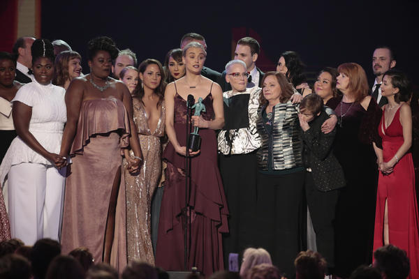 "The ""Orange Is the New Black"" cast gathers onstage after winning for ensemble in a comedy series. (Robert Gauthier / Los Angeles Times)"