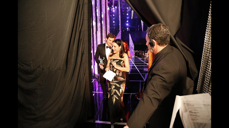 Ashton Kutcher and Julia Louis-Dreyfus backstage at the 23rd Screen Actors Guild Awards. (Al Seib / Los Angeles Times)