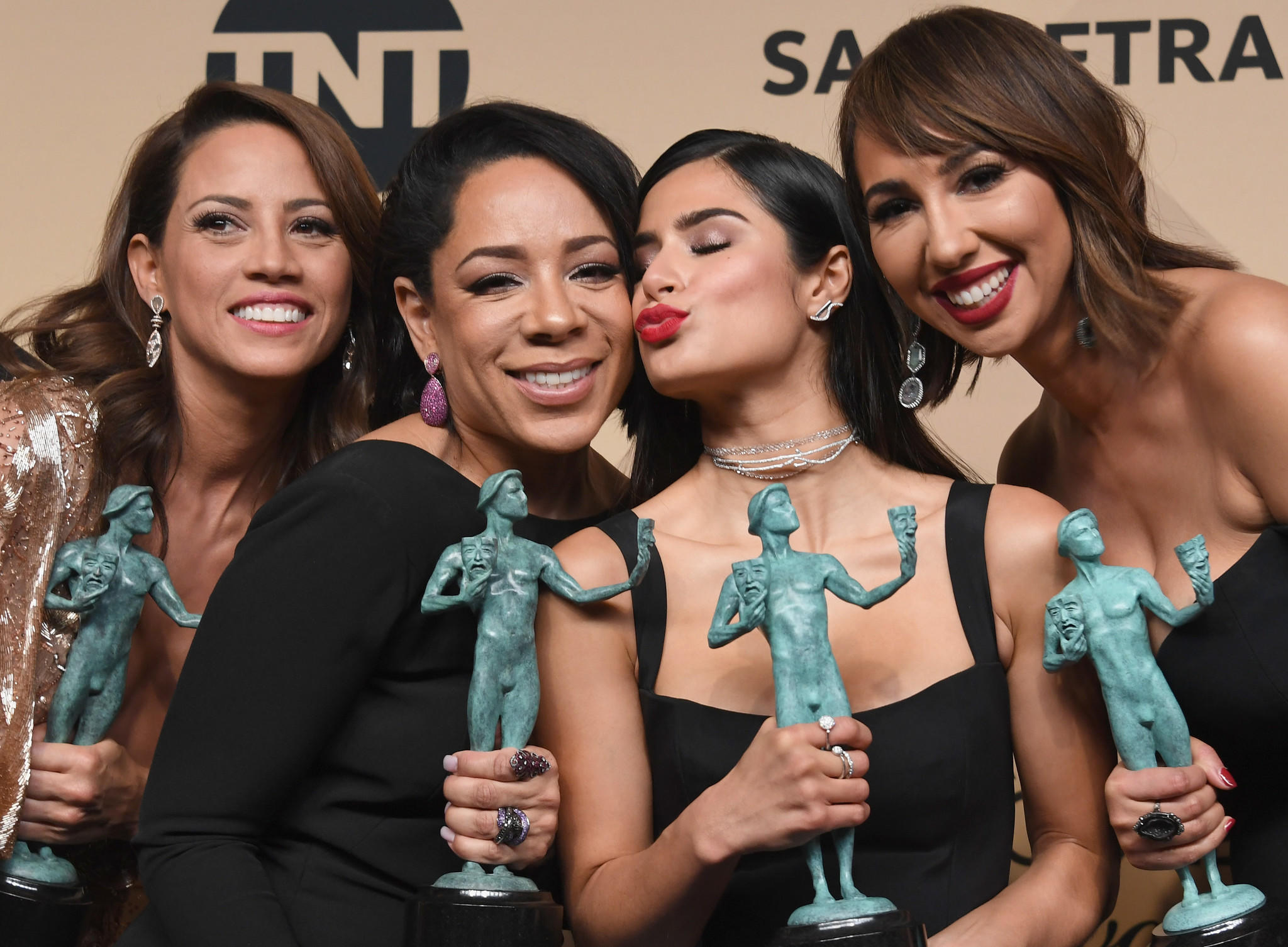 "Elizabeth Rodriguez, left, Selenis Leyva, Diane Guerrero and Jackie Cruz, co-winners of ensemble in a comedy series for ""Orange Is the New Black."" (Alberto E. Rodriguez / Getty Images)"