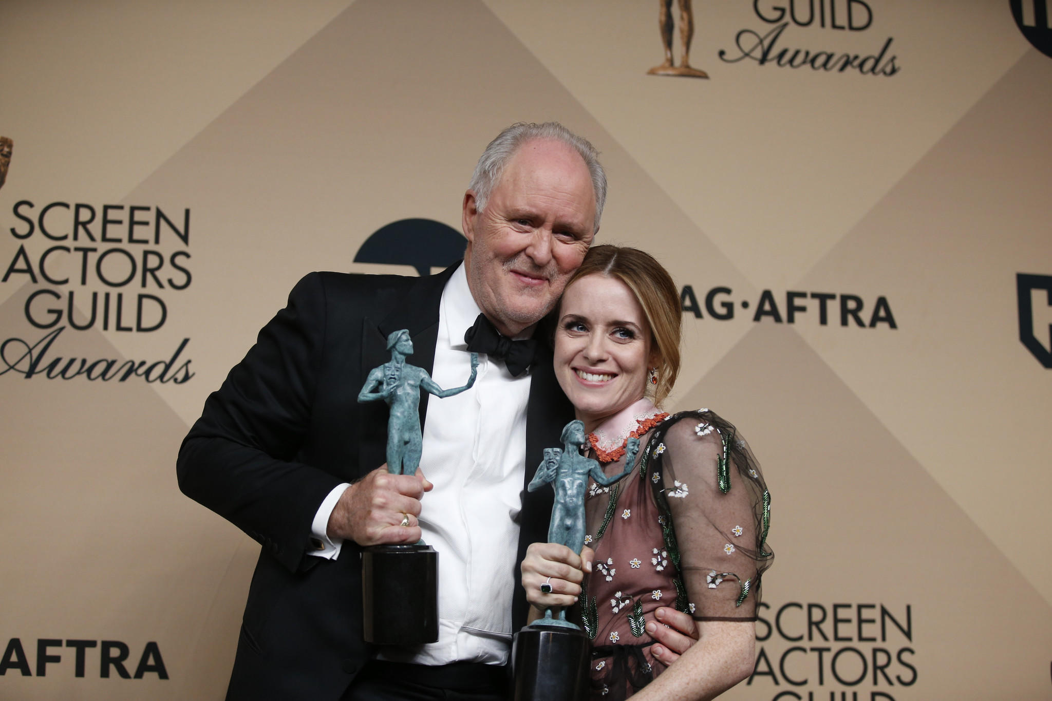 """The Crown's"" John Lithgow, winner for male actor in a drama series, with costar Claire Foy, winner for female actor in a drama series. (Frazer Harrison / Getty Images)"