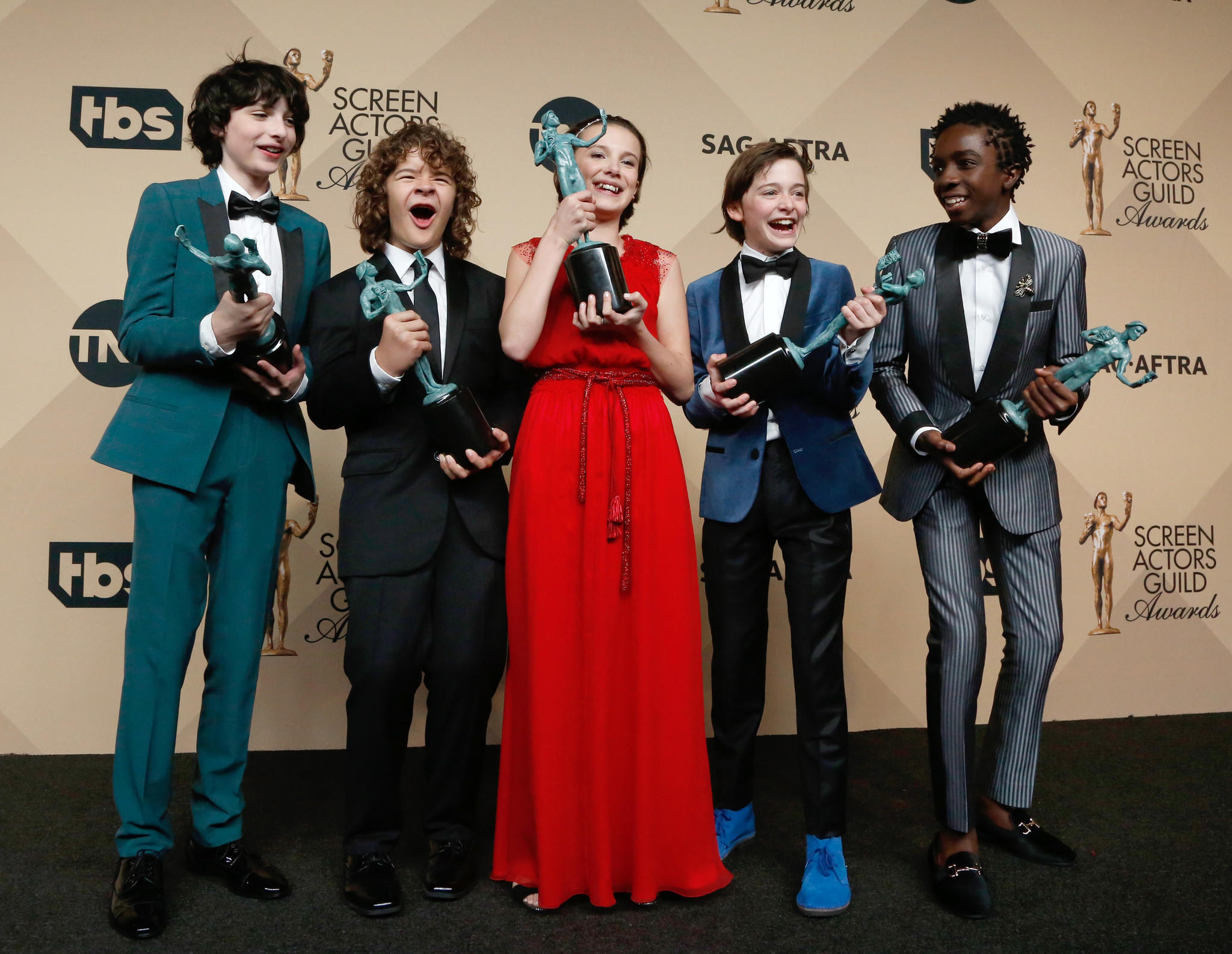 "Finn Wolfhard, left, Gaten Matarazzo, Millie Bobby Brown, Noah Schnapp and Caleb McLaughlin, winners of ensemble in a drama series for ""Stranger Things."" (Paul Buck / European Pressphoto Agency)"