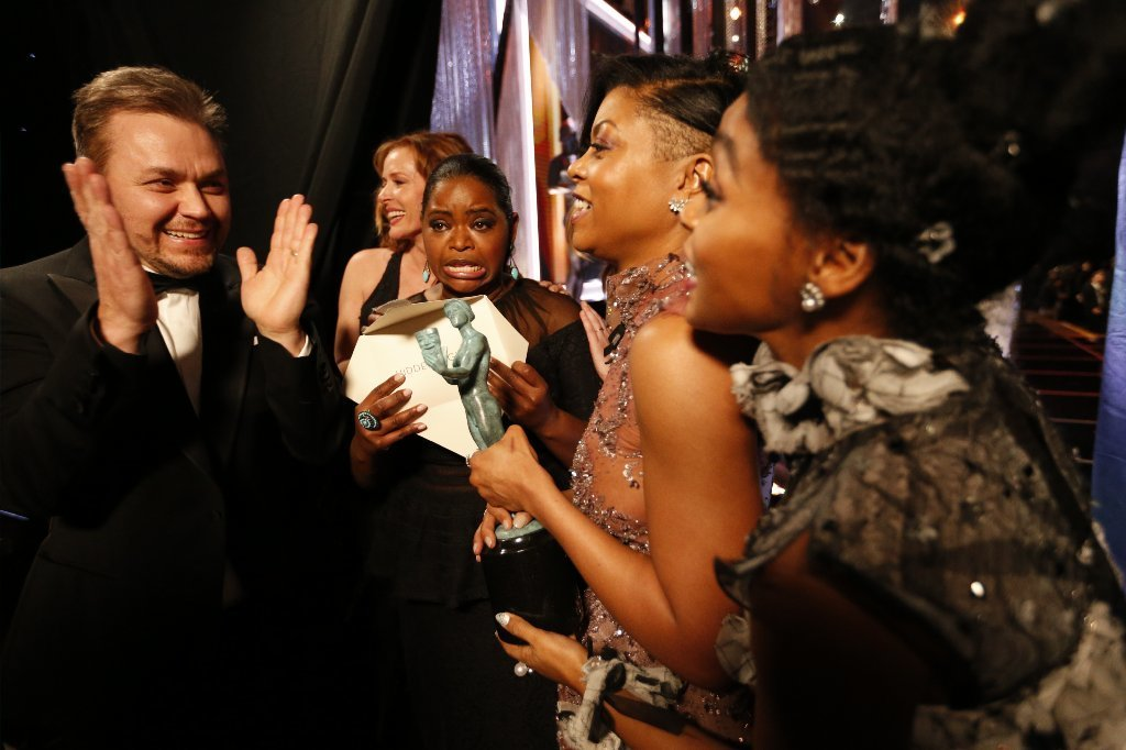 """Hidden Figures"" writer-director Theodore Melfi and actors Octavia Spencer, Taraji P. Henson and Janelle Monáe celebrate after winning for outstanding performance by a cast in a motion picture. (Al Seib / Los Angeles Times)"