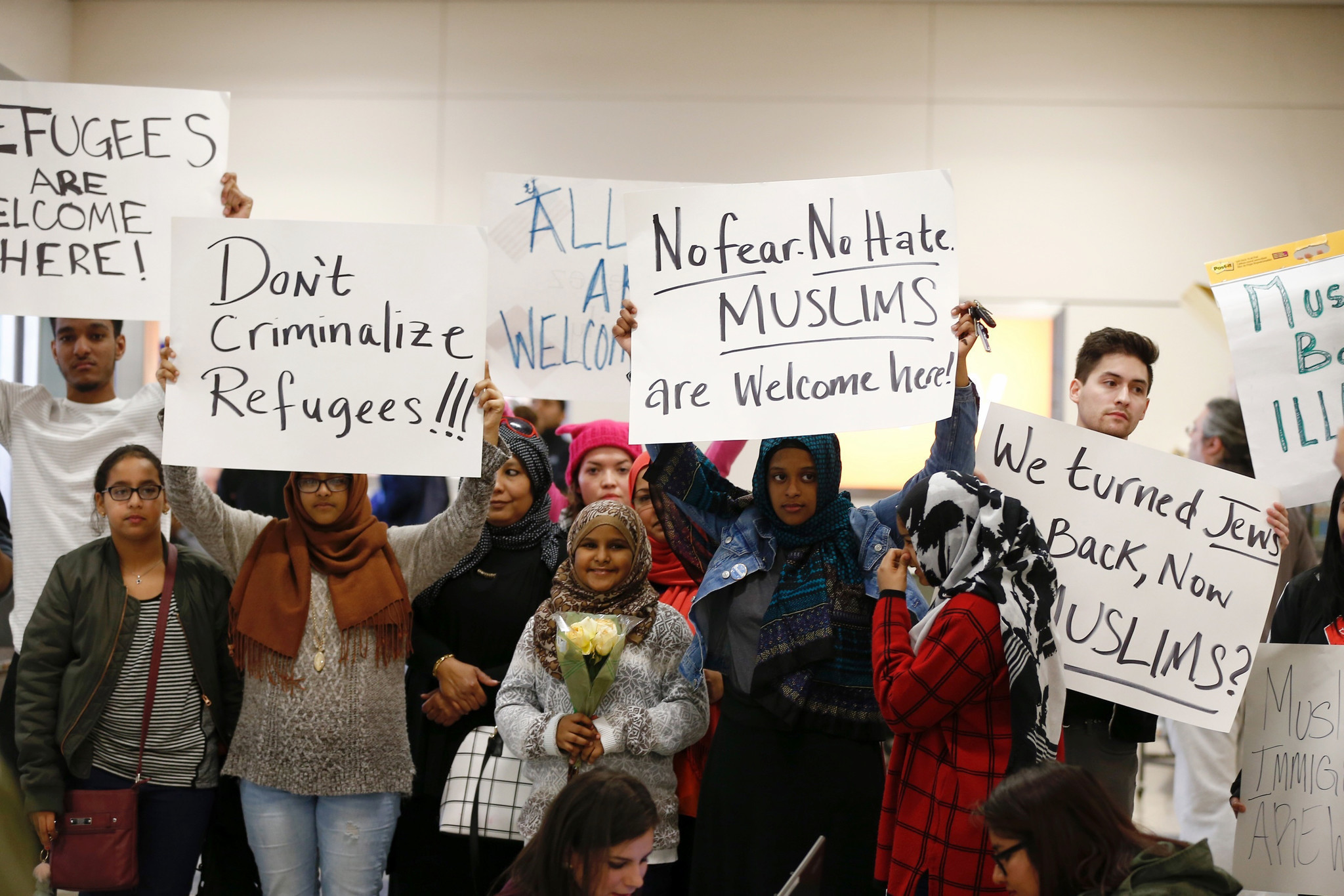 Protesters at Dallas-Forth Worth International Airport demonstrate on Jan. 28 against President Trump's executive order restricting refugees and immigrants from seven Muslim-majority countries. (Brandon Wade / Associated Press)