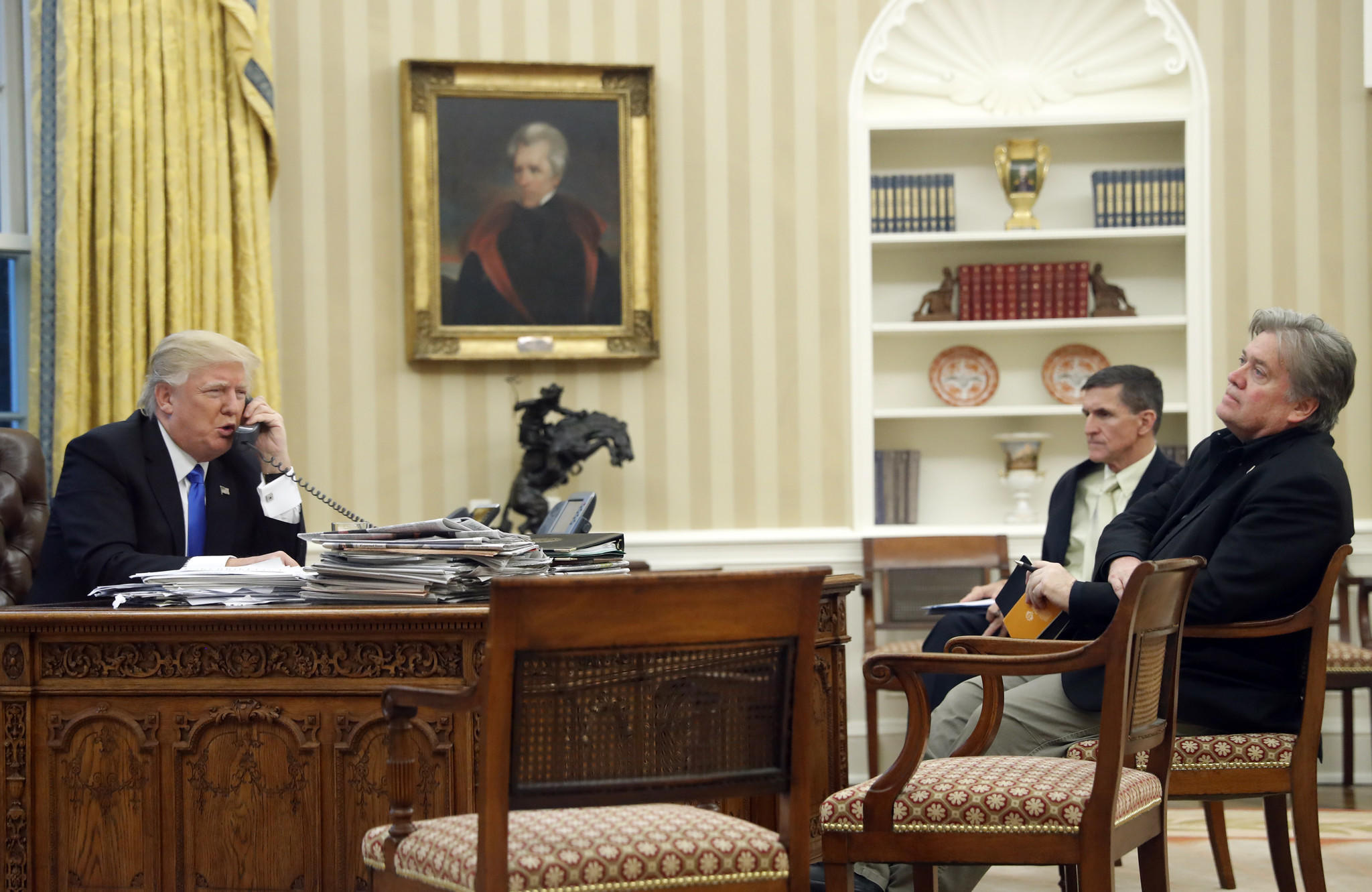 President Trump with chief strategist Steve Bannon, right, and National Security Adviser Michael Flynn, center, in the Oval Office. (Alex Brandon / Associated Pres)