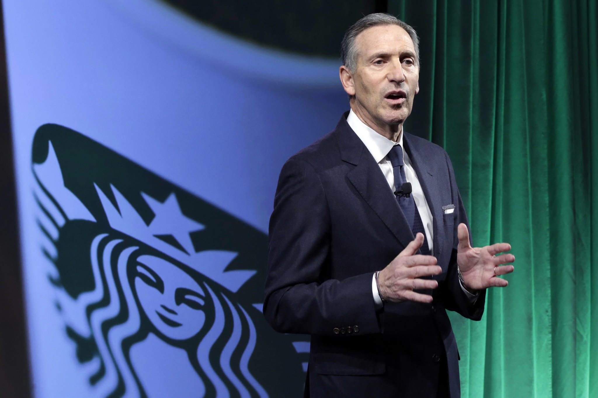 Starbucks Chief Executive Howard Schultz said the Seattle coffee company is developing plans to hire 10,000 refugees over the next five years. (Richard Drew / Associated Press)