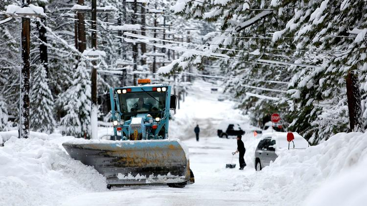 A plow removes snow along Aspen Ave., in South Lake Tahoe in January.