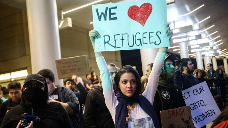 Protesters gather in front of the Tom Bradley International Terminal at Los Angeles International Airport after President Trump halted travel from seven majority-Muslim countries. (Patrick T. Fallon / For The Times)