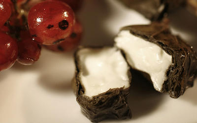 Grilled feta in grape leaves