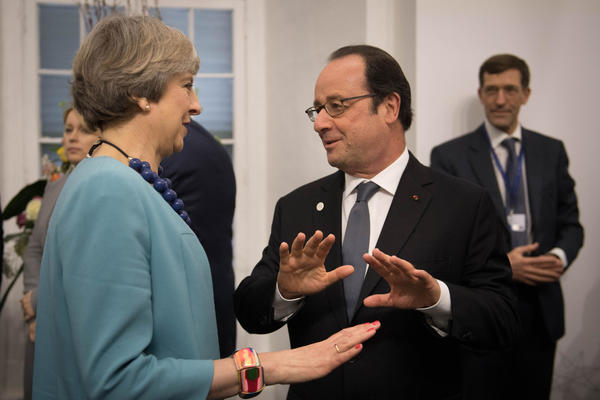 British Prime Minister Theresa May speaks with French President Francois Hollande during a meeting of European leaders in Malta. (WPA Pool / Getty Images)