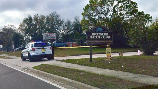 Orange County Sheriff's deputies investigate near the scene of the shooting.