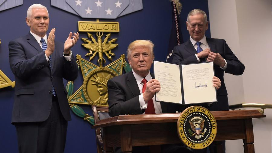 President Trump signs an executive order on Jan. 27 banning people in seven predominantly Muslim nations from traveling to the United States. Federal judges have since blocked the order. (Mandel Ngan / AFP/Getty Images)