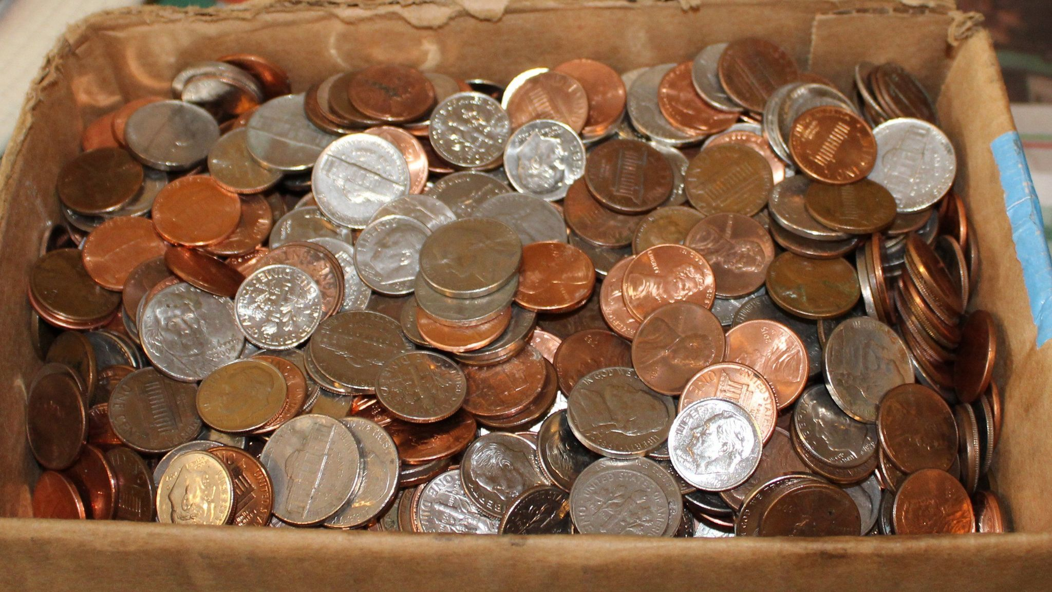 Greg Chick leaves a box full of change for Don Owen to donate to whom he wishes.