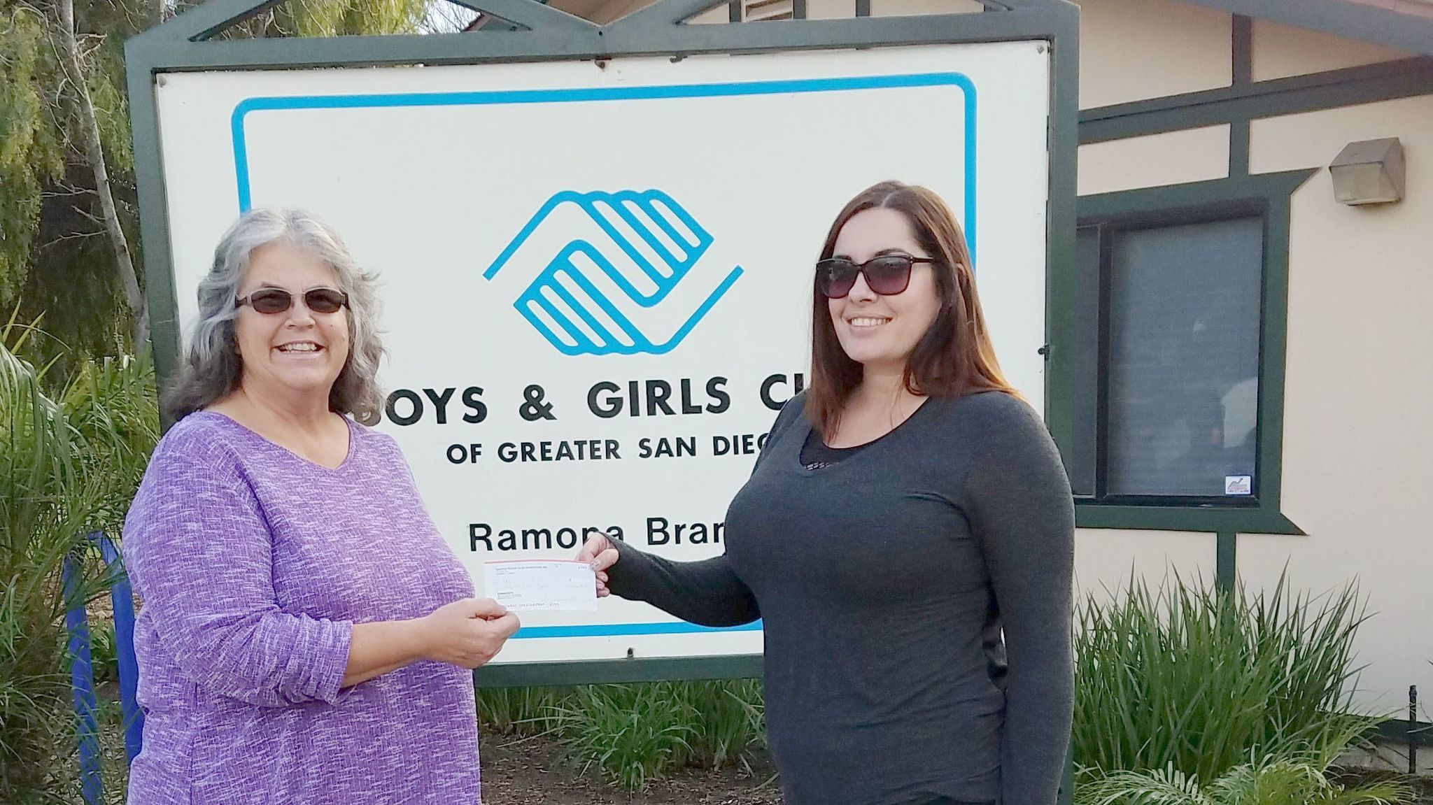 On behalf of Ramona Rotary Club, Kim Lasley, left, the club's president, presents Simone McCune, supervisor of the Ramona Branch of the Boys & Girls Club of Greater San Diego, with a check for $250 for the club at 622 E St. in Collier Park.