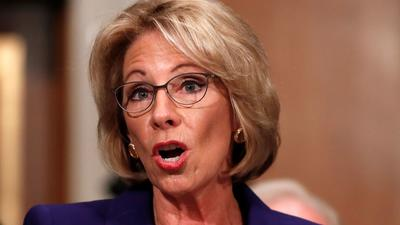 Betsy DeVos squeaks through as Education secretary after Pence casts first-ever tie-breaking vote