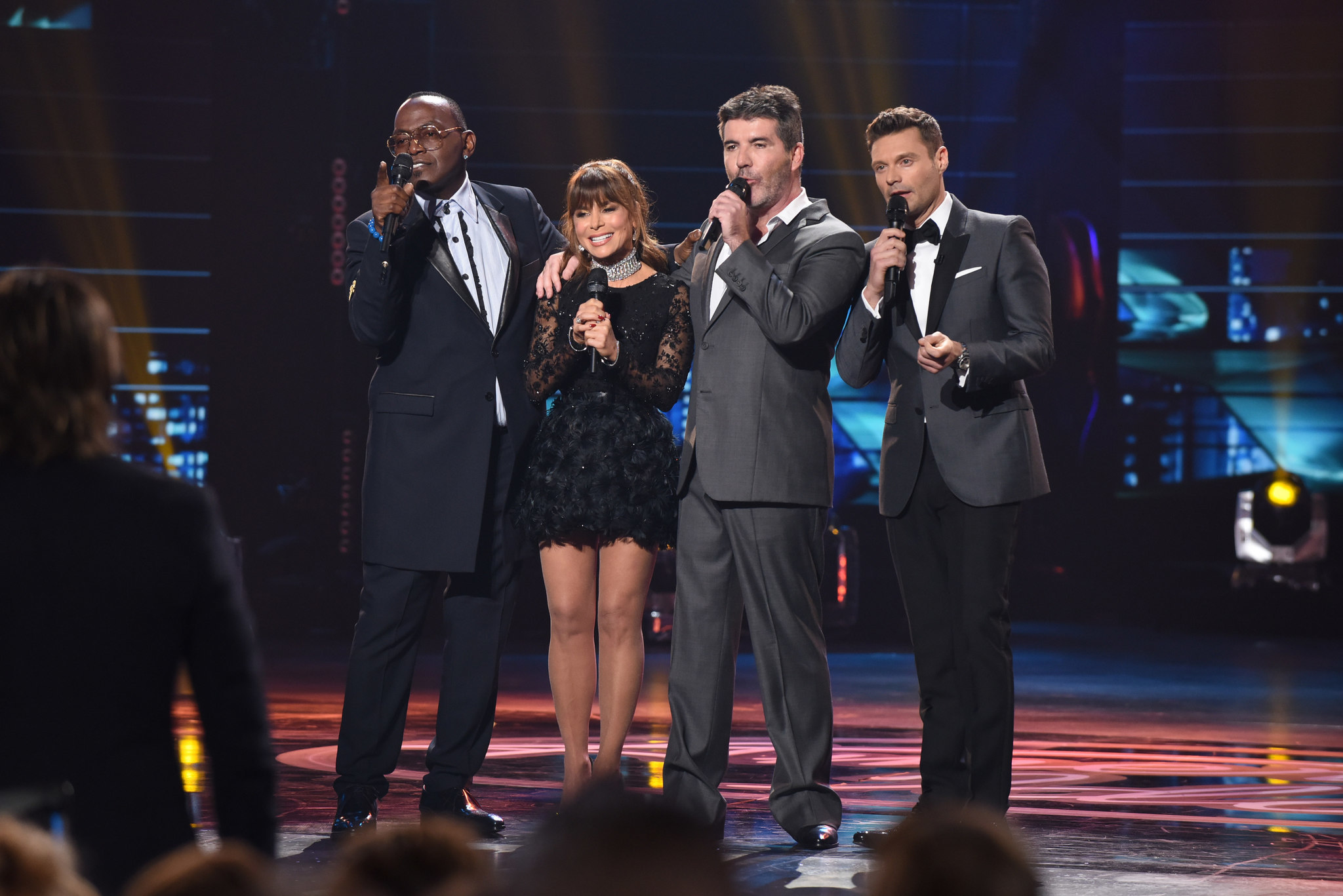 """American Idol"" judges Randy Jackson, left, Paula Abdul, Simon Cowell and host Ryan Seacrest at the finale. (Ray Mickshaw / Fox)"