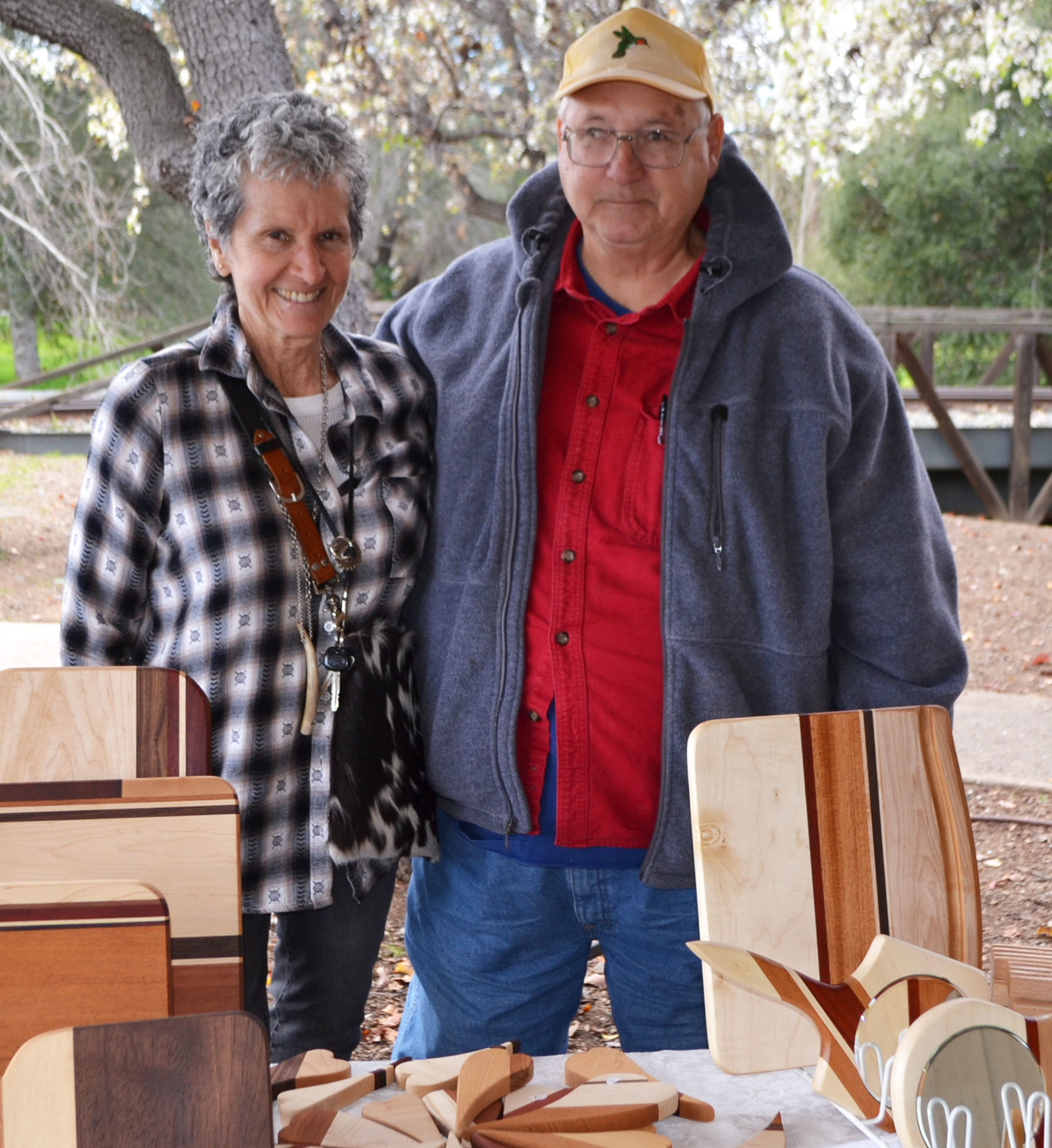 Dennis Caldwell, president of the Poway Arts and Crafts Guild, with his wife Leslie. The Caldwells have sold their handmade woodworking crafts at the Boardwalk Craft Market for about 10 years.