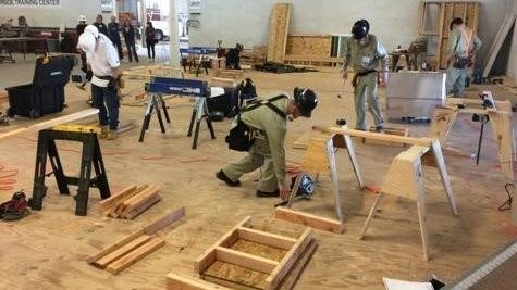 Dartanian Danks, Chase Henderson, and Chase Miller work on their projects during Individual Carpentry competition.