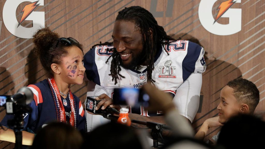 New England Patriots' LeGarrette Blount appears at a news conference with his family after the NFL Super Bowl 51 football game against the Atlanta Falcons Sunday, Feb. 5, 2017, in Houston.