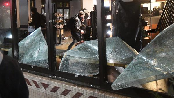 Rioters loot and vandalize a Starbucks store during a protest against Breitbart News editor Milo Yiannopoulos in Berkeley.
