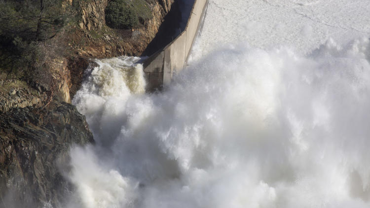 Water from Lake Oroville flows down a damaged main spillway. (Brian van der Brug/Los Angeles Times)