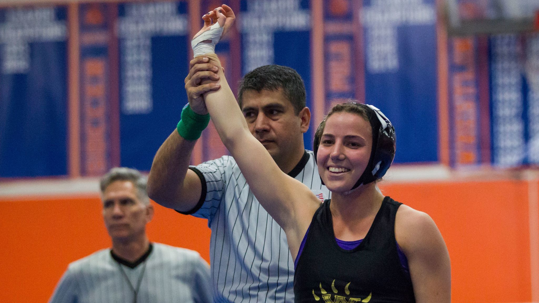 SAN DIEGO, February 11th, 2017 | 2017 CIF San Diego Section girls wrestling championships held at Clairemont  High School. Westview's Claire Bjork smiles after pinning San Diego's Esmerelda Ibarra for a fast 18 second fall in the 139lb division. Chadd Cady for The San Diego Union-Tribune