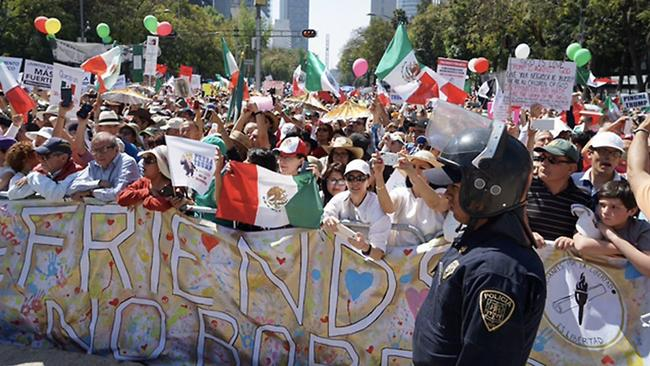 Demonstrators march along Paseo de la Reforma in Mexico City on Feb. 12, 2017, protesting the immigration and trade policies of President Trump.