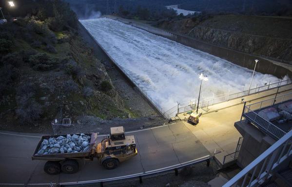 Crews work to repair California dam as storms loom
