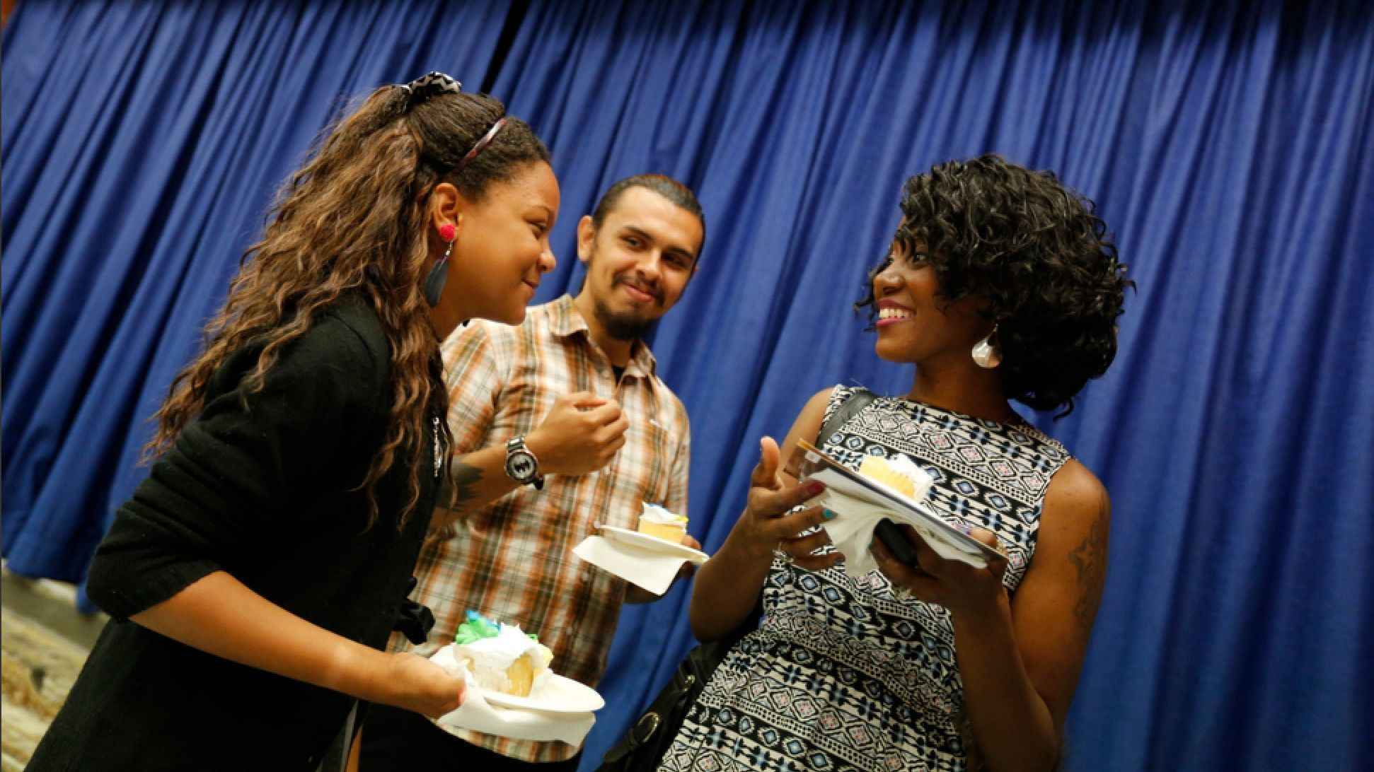 Angelica, Sanchez and Baker enjoyed cake after a reception following Angelica's sixth grade graduation.
