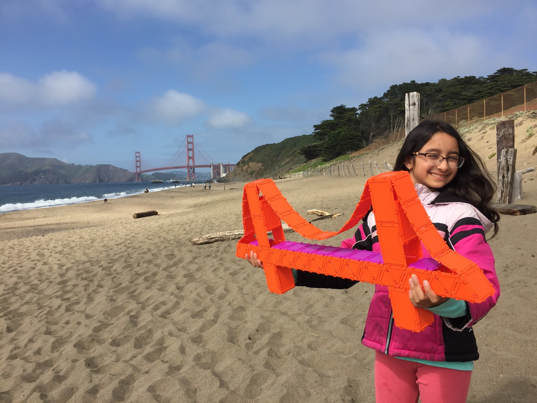Yana Mohanty's daughter Nina shows off a Golden Gate Bridge made of Geometiles.