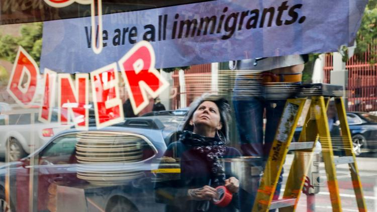 """The Nickel Diner in downtown Los Angeles hung a sign in solidarity with the national """"Day Without Immigrants."""" (Mark Boster / Los Angeles Times)"""