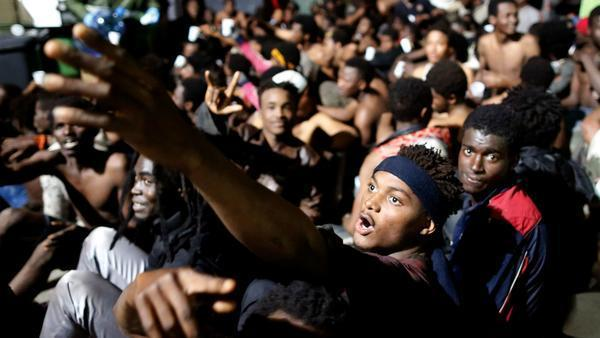 Almost 500 migrants smash through border fence, reach Spanish territory in North Africa