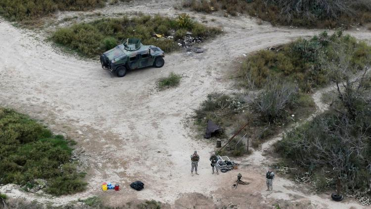 Members of the National Guard patrol along the Rio Grande at the Texas-Mexico border in Rio Grande City, Texas, in February 2015. (Eric Gay / Associated Press)