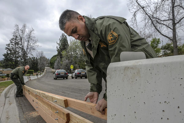 Deputies put up barriers in Duarte Friday afternoon (Irfan Khan / Los Angeles Times)
