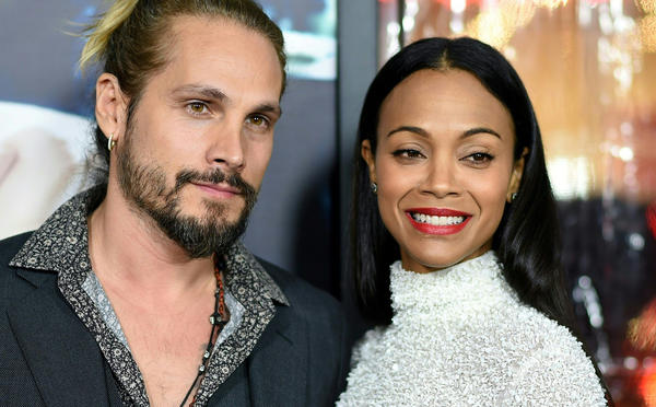 Zoe Saldana and husband Marco Perego (Robyn Beck / AFP/Getty Images)