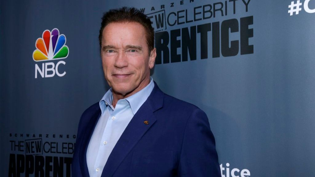 """This Dec. 9, 2016 image released by NBC shows Arnold Schwarzenegger, the new boss of """"The New Celebrity Apprentice, """" at a press junket in Universal City, Calif."""