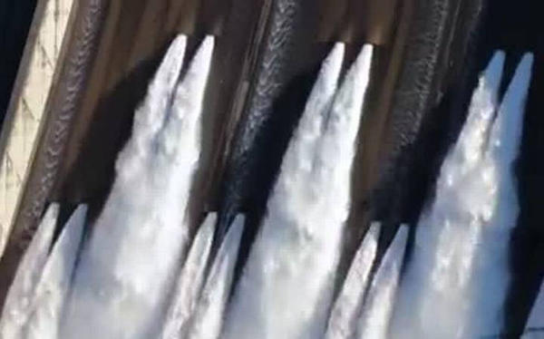 Water released from Shasta Dam's top gates for first time in nearly two decades