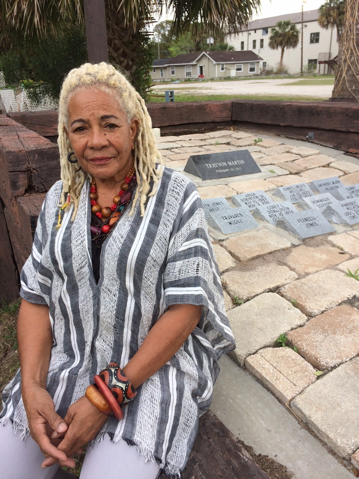 """Francis Oliver, 73, a longtime activist in Sanford's black community, at the Trayvon Martin memorial. The memorial also includes stones marked with the names of other young black people killed in Sanford before Trayvon. """"Sanford and Trayvon Martin are still ground zero,"""" she said."""