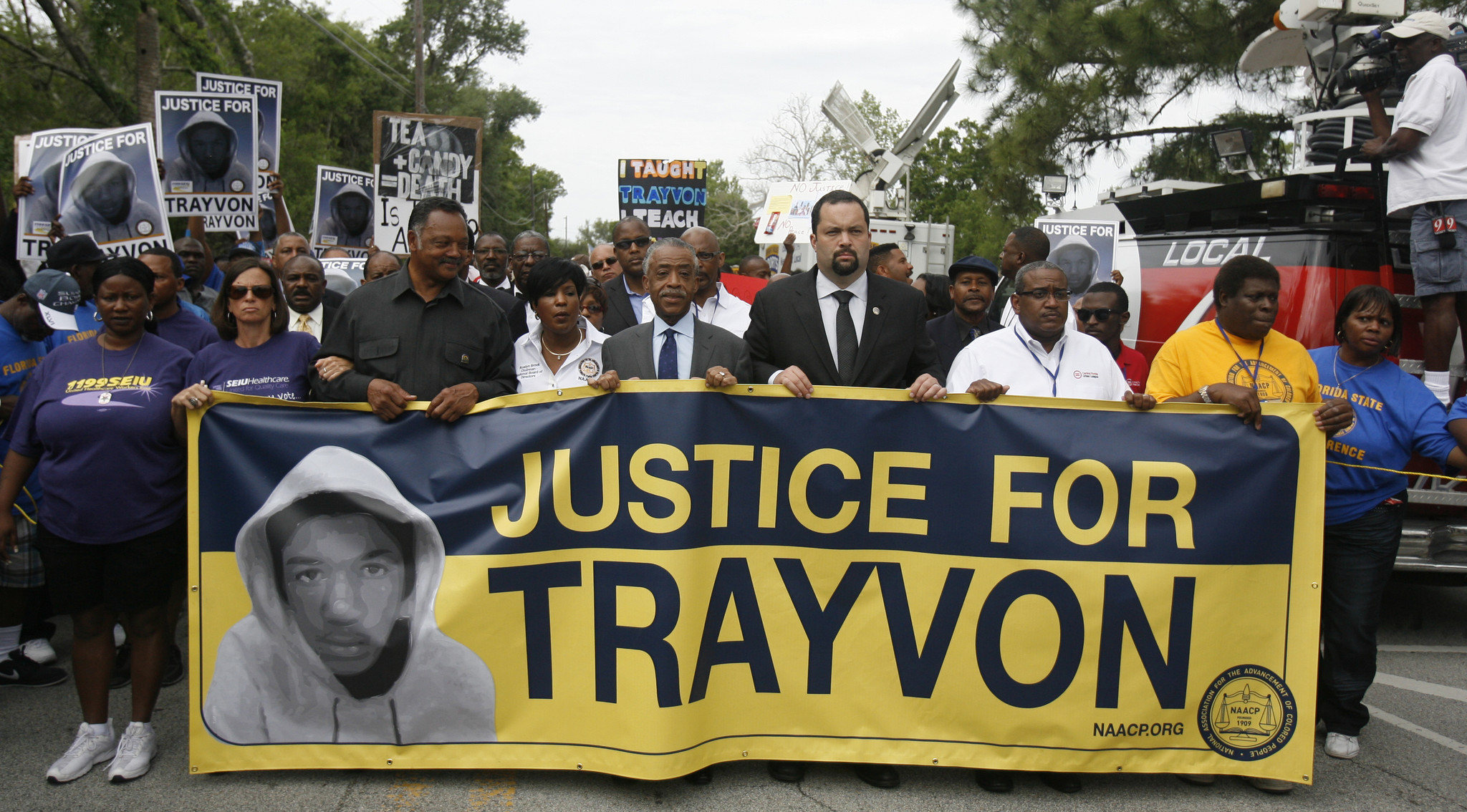The Rev. Jesse Jackson, 3rd from left, marches with the Rev. Al Sharpton, center, and NAACP President Ben Jealous, center right, during a rally along W. 13th Street in Sanford, Florida, Saturday, March 31, 2012.