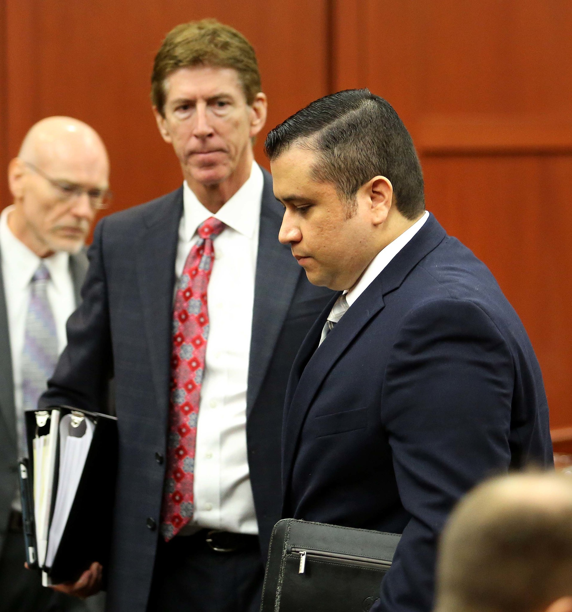 George Zimmerman leaves the courtroom during a recess, with his attorney Mark O'Mara,  in Seminole circuit court on the first day of his trial, in Sanford, Fla., Monday, June 10, 2013.