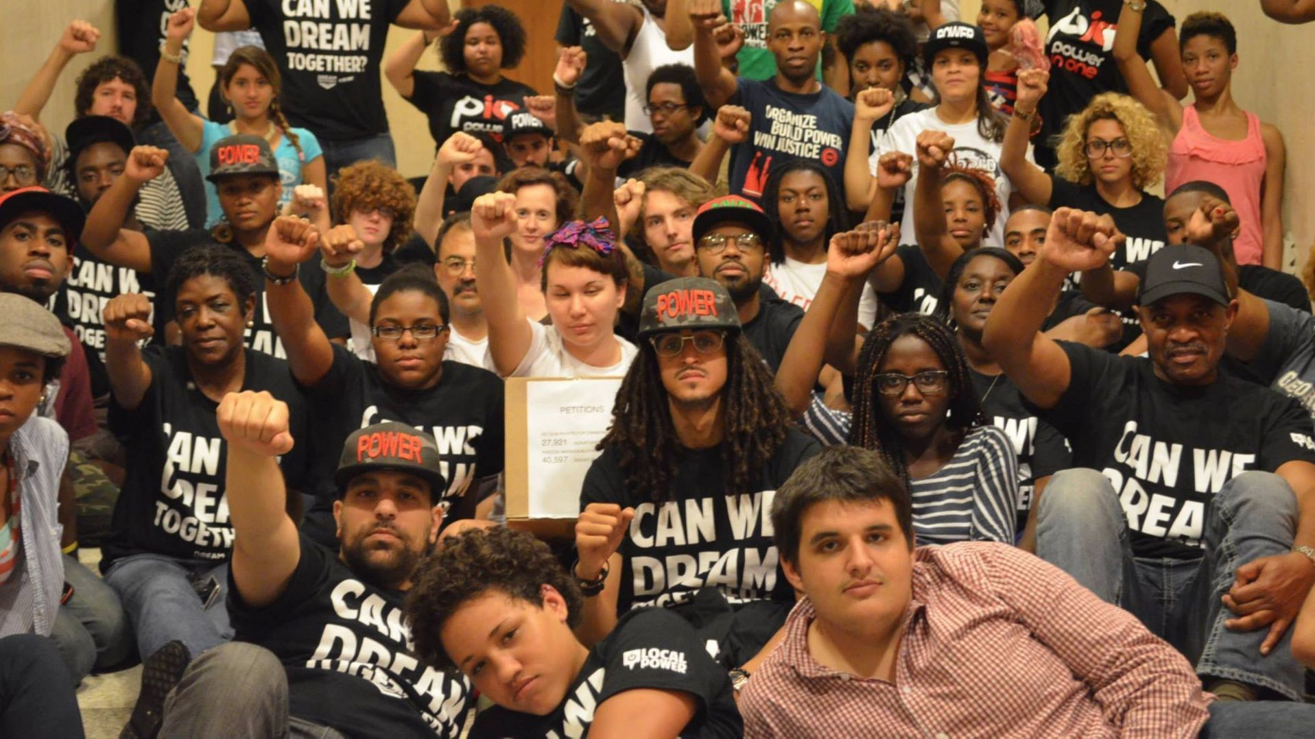 Curtis Hierro (front corner in the red and white shirt) at a sit-in outside the governor's office in Tallahassee on Aug. 13, 2013. After George Zimmerman was acquitted, protesters occupied the hallway for 31 days, demanding a repeal of Florida's Stand Your Ground law.