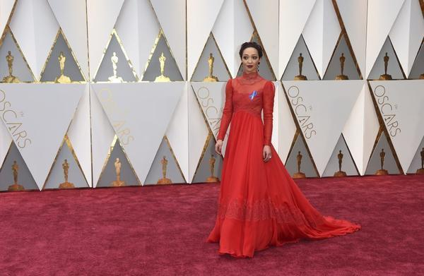 Leading actress nominee Ruth Negga arrives wearing what's sure to be this year's Oscar must-have accessory