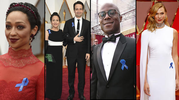 Blue ACLU ribbons make a statement on the Oscars red carpet