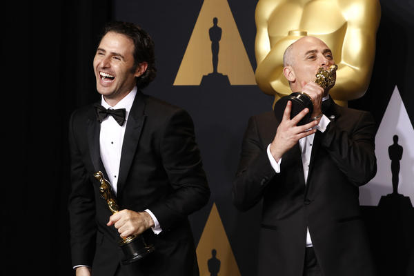 Marc Sondheimer and Alan Barillaro onstage at the Oscars. (Marcus Yam / Los Angeles Times)