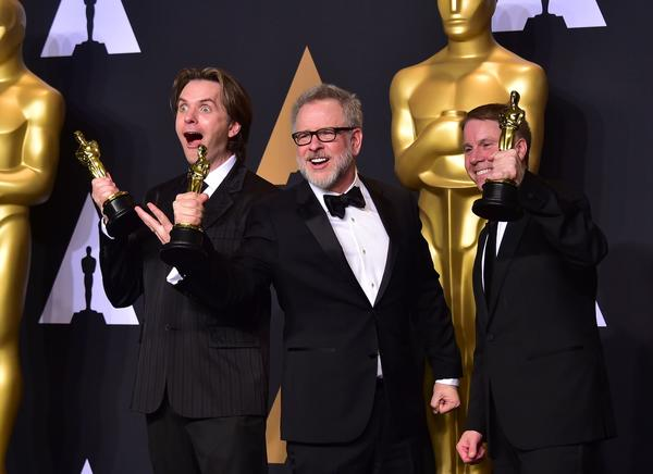 Byron Howard, left, Rich Moore and producer Clark Spencer (Frederic J. Brown / AFP)
