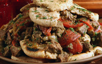 Moroccan lamb tagine with melting tomatoes and onions